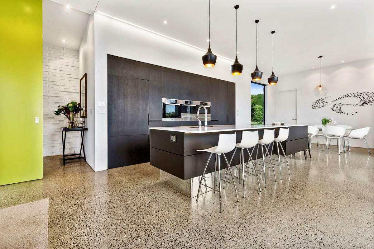 Highly polished concrete floor with a deep grind exposing the aggregate.