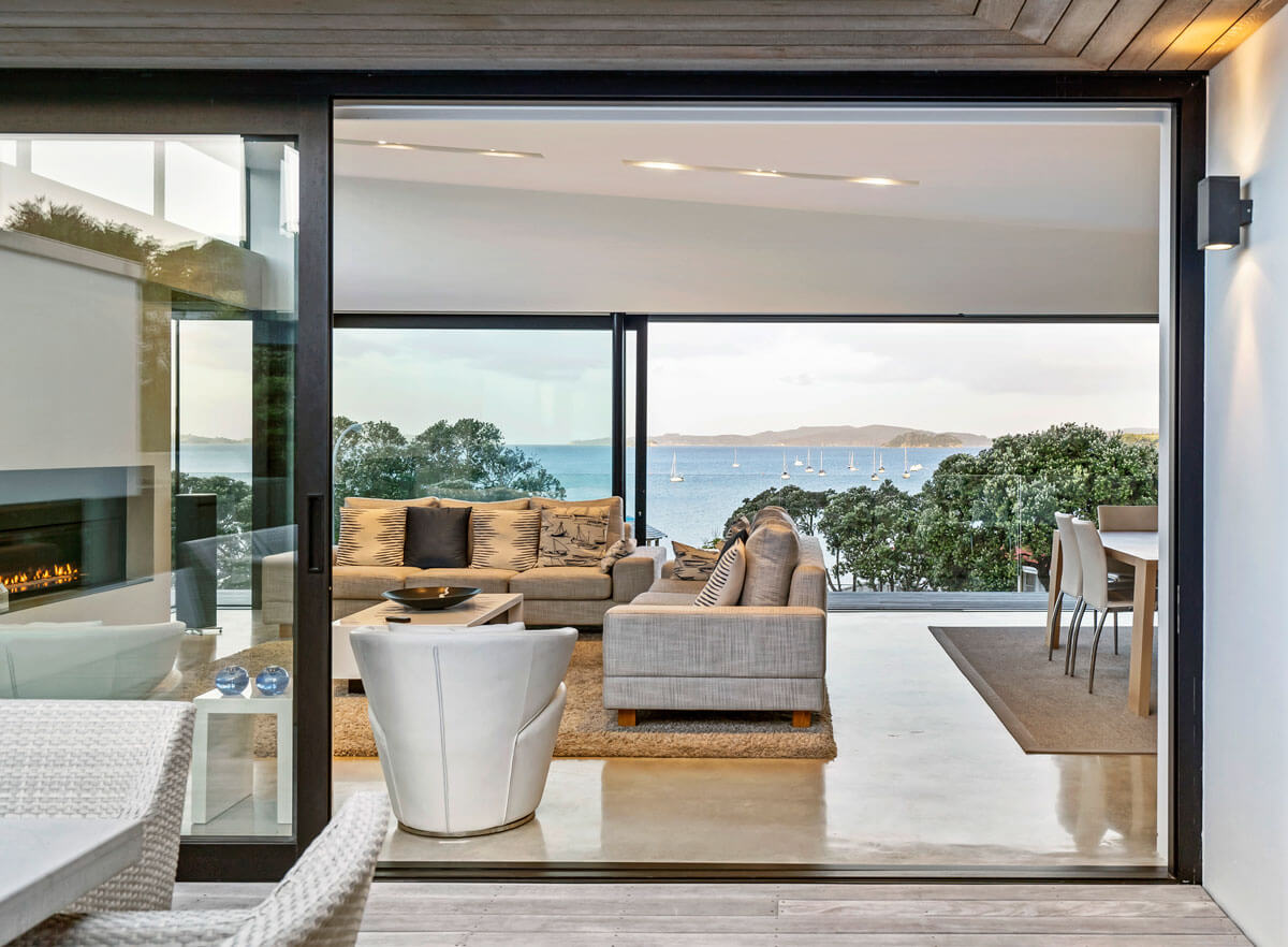 coloured concrete floor in Auckland home overlooking Rangitoto Island.