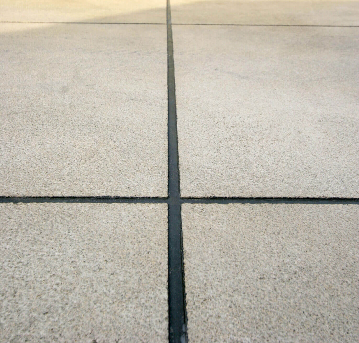 decorative concrete cuts filled with grout.
