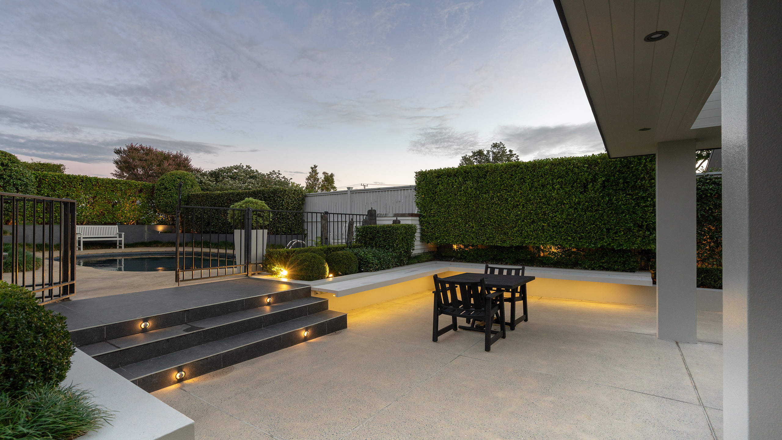 coloured concrete patio and courtyard at Auckland home.
