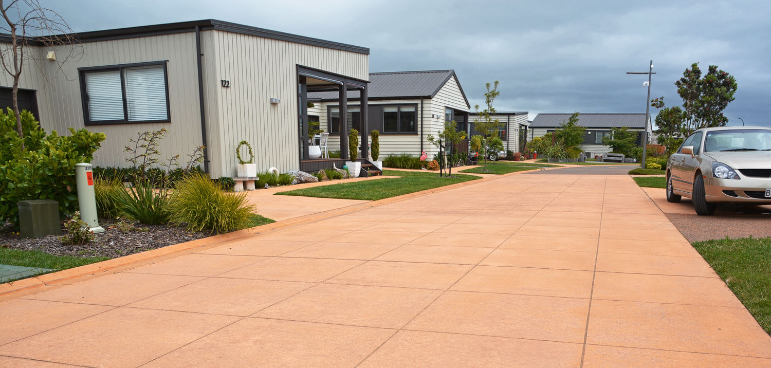 bright coloured concrete driveway with decorative cut pattern