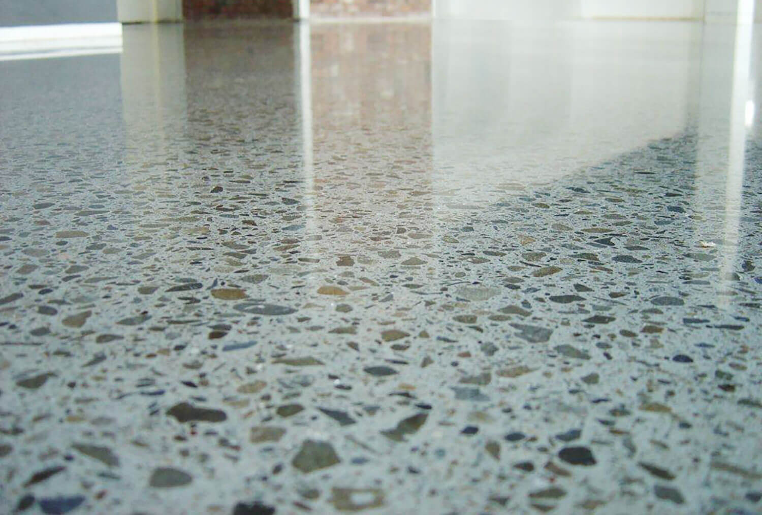 polished concrete floor looks super shiny after being cleaned and sealed
