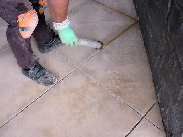 Grout being applied with a PFL grout gun.