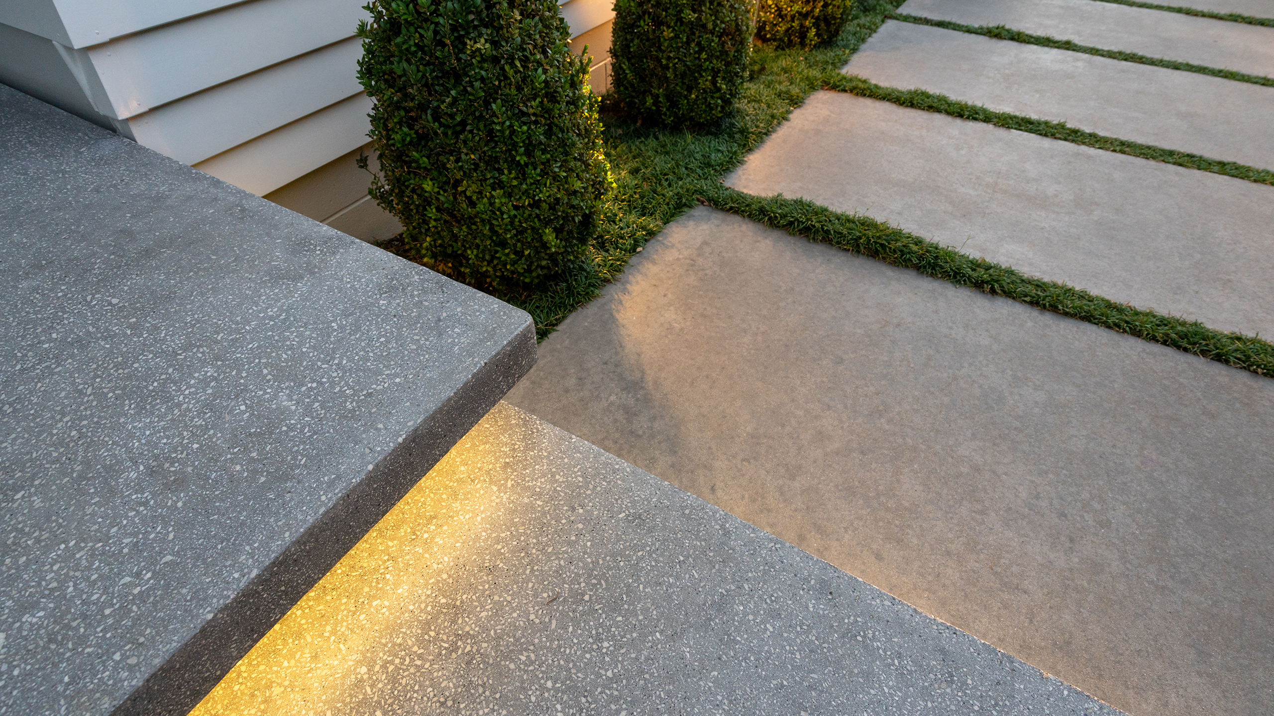 coloured concrete paths in manicured garden