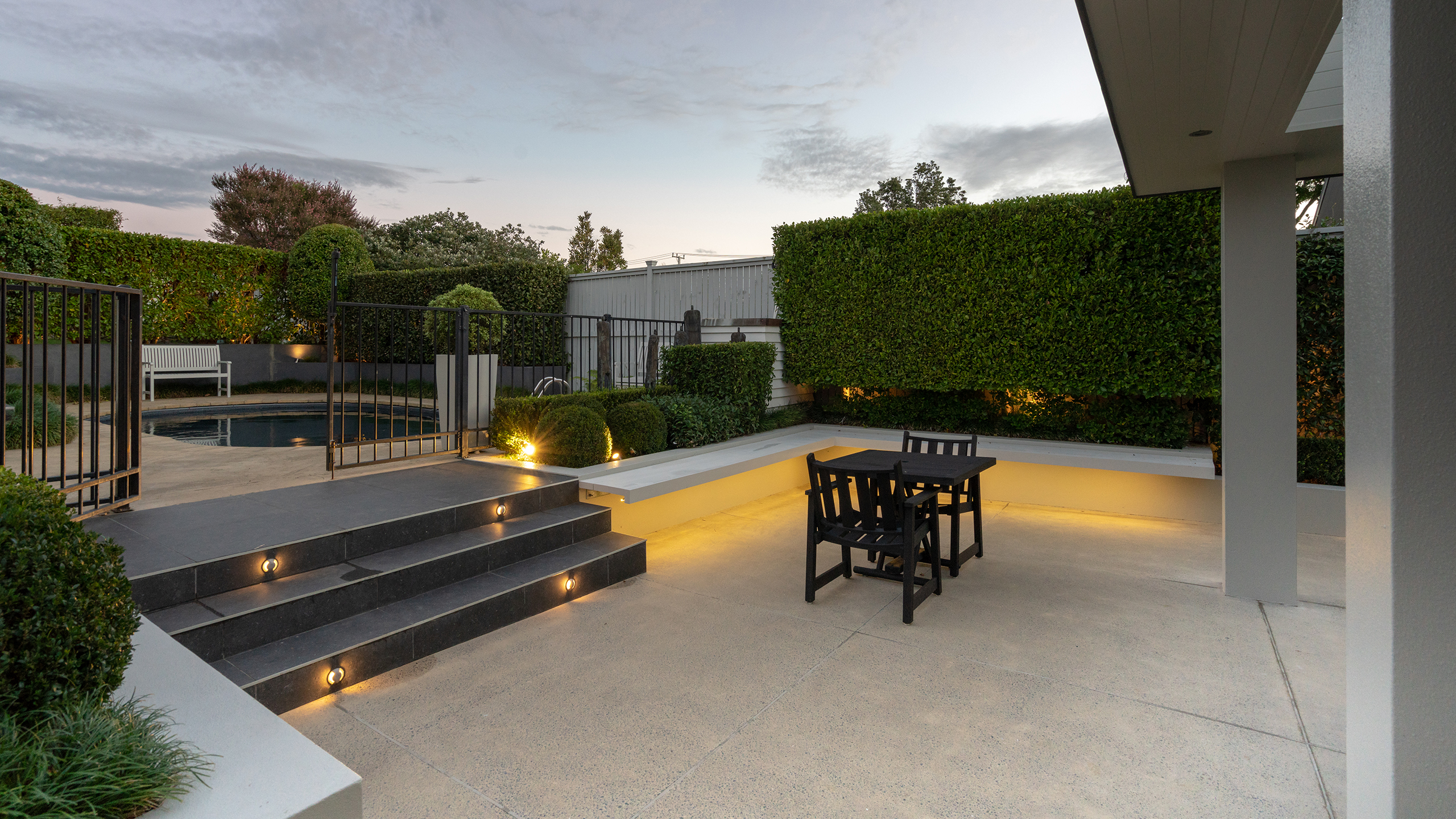 concrete patio and pool surround
